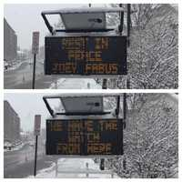 """A sign on Washington Road says """"Rest In Peace Joey Fabus ... We Have The Watch From Here"""" in honor of the 8-year-old boy who wanted to be a police officer."""
