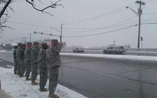 A final salute as the hearse passes the U.S. Army Recruiting Center on Washington Road en route to Saint Bernard Parish in Mt. Lebanon.