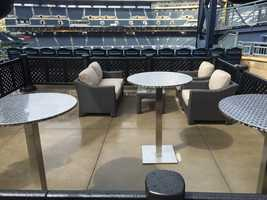 Porch style seating areas available to rent for game night!