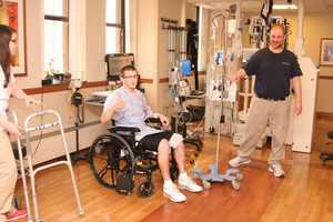 THUMBS UP: Sean letting us know he's progressing well during a physical therapy session.