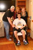 FRIENDS AND FAMILY: Sean takes a break from PT for a visit with his life-long friend Garrett Lynn, his Mom, Sue, and sister Tara.