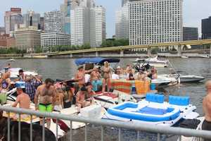 Check out photos from the Kenny Chesney fans who held pre-concert celebrations on the river and along the North Shore waterfront.
