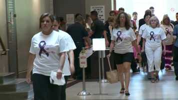 Several people attended a hearing for Taura Krill-McCormick wearing shirts with pictures of her dogs that died.