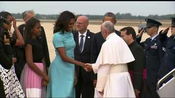 First Lady Michelle Obama greets Pope Francis.