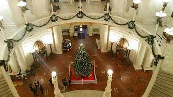 In the rotunda of the State Capitol Building, a 22-foot Douglas fir is decorated with 500 ornaments and 800 LED lights.