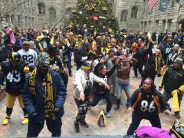 Pittsburgh Steelers fans celebrate at the city's playoff rally.