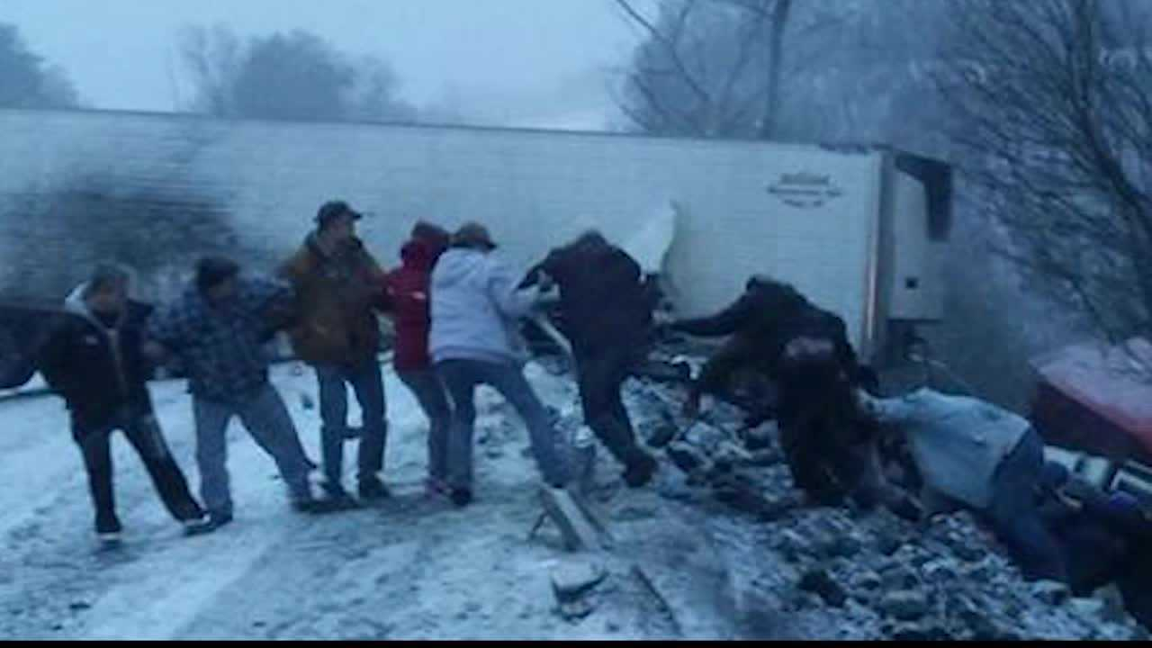 img-Strangers band together form human chain to save truck driver teetering over PA Turnpike hillside