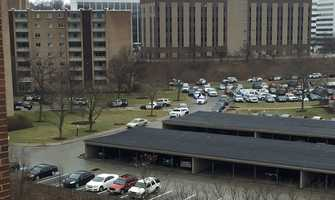 Police cars are lined up at the Laurel Village Apartments at Penn Center East in Wilkins Township.