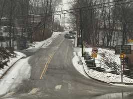 Cars were sliding sideways down Potomac Avenuebecause of slick conditions. This is the view from Banksville Road.
