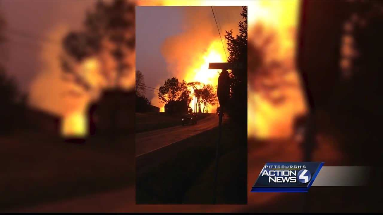 img-Charred grass damaged home remain after gas explosion