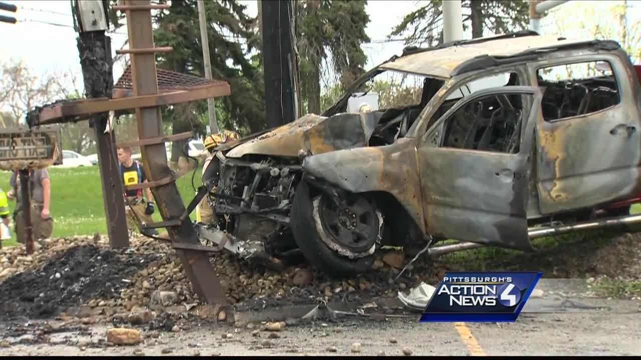 Pickup truck catches fire after crashing into sign in Irwin