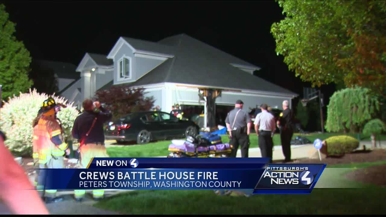 Crews battle garage fire in Peters Township