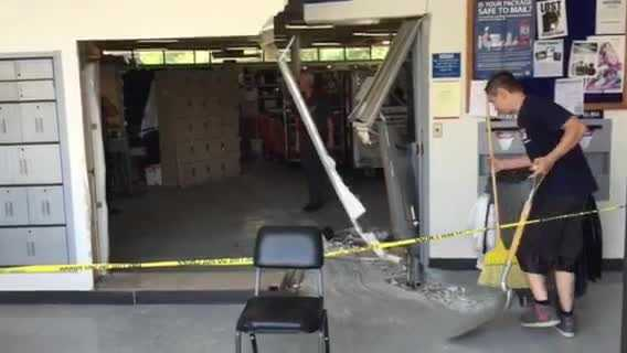 img-Raw Car crashes into post office