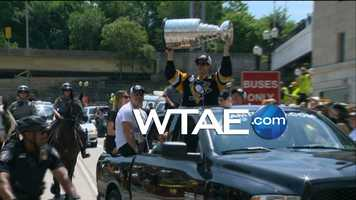 Sidney Crosby rides with the Stanley Cup in the Penguins parade.