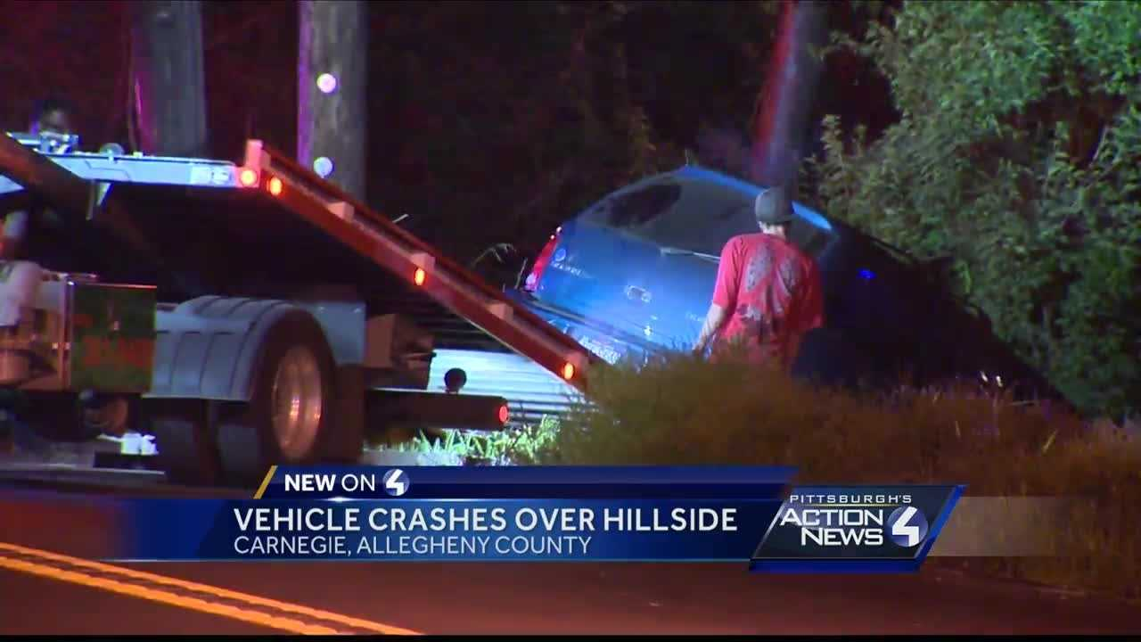 Car goes over hillside in Carnegie