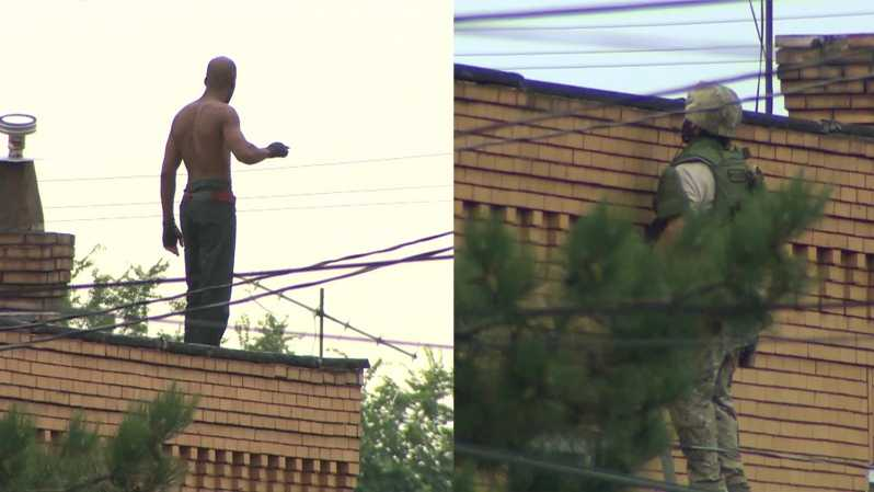 standoff suspect on roof police