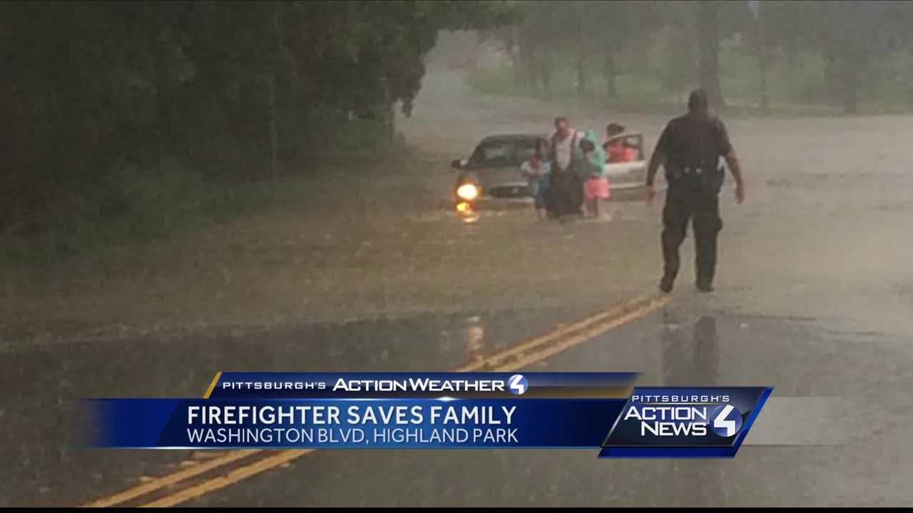 img-Volunteer firefighter saves family trapped in Washing Blvd flood
