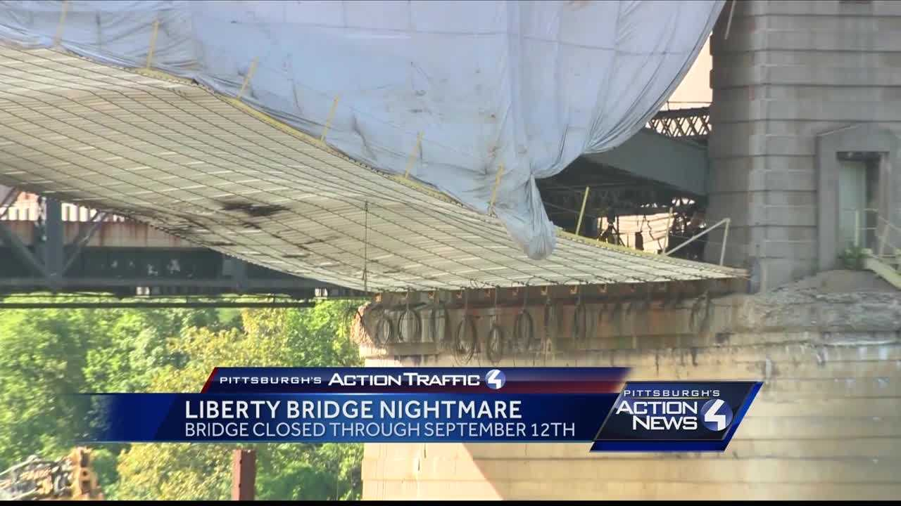 img-Minutes from collapsing Liberty Bridge remains closed after fire