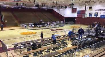 A media area is set up for the campaign rally.