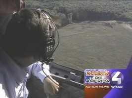 Pennsylvania Gov. Tom Ridge views the Flight 93 crash site from above.