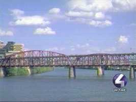 "In 2001, the Pittsburgh History & Landmarks Foundation suggested giving city bridges a new image. If they had their way, the spans would be repainted in a rainbow of colors. Here's how the LRT Bridge for Port Authority trolleys would look if it were decked out in so-called ""purple ice."""