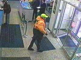 These surveillance images are from the Bloomfield Post Office on Liberty Avenue.