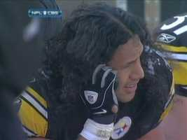 Troy Polamalu makes a cellphone call on the Steelers sideline