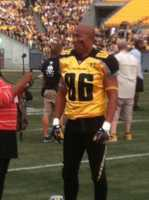"Hines Ward wears a Gotham Rogues uniform for a football scene in ""The Dark Knight Rises."""