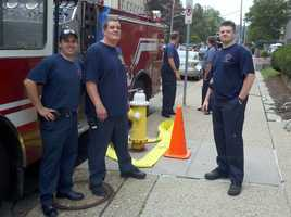 "Pittsburgh firefighters on standby for an explosion scene on ""The Dark Knight Rises"" movie set in Oakland."