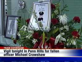 A flower arrangement to honor fallen Penn Hills police officer Michael Crawshaw