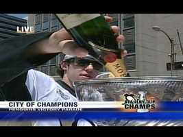 Stanley Cup Playoffs MVP Evgeni Malkin broke out the bubbly at the Penguins' victory parade.