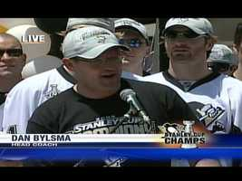 Coach Dan Bylsma speaks to the crowd at the end of the parade route.