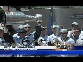 Penguins captain Sidney Crosby holds the Stanley Cup during a Stanley Cup victory parade downtown.