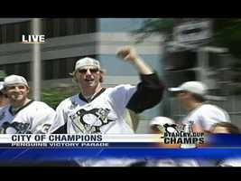 Penguins forward Jordan Staal salutes the crowd along Grant Street.