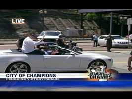 Penguins owner Mario Lemieux kicked off the parade, riding in the first car.