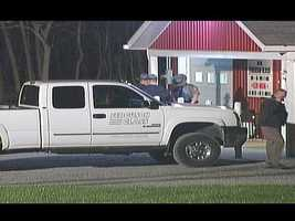 Police seized a white pickup truck with the Ferguson Glass logo on it as part of the investigation.