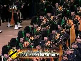 Pipers played as the caskets were brought into the Petersen Events Center for the memorial service.