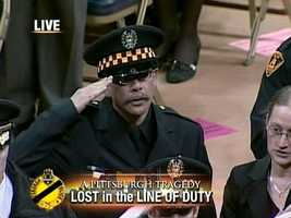 Officer Timothy McManaway salutes the fallen.