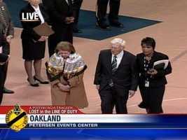 Dan Rooney, his wife Pat and police spokeswoman Diane Richard arrive at the memorial.