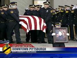 The casket carrying Officer Paul Sciullo leaves the viewing.