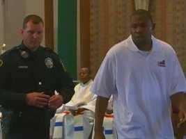 Sam Ashaolu is seen here at the service, next to a Duquesne University police officer.