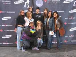 Justin Timberlake poses with Traffic Watch 4 reporter Melanie Taylor and other fans.