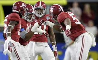After sacking Michigan State quarterback Connor Cook, Alabama defensive lineman Jonathan Allen (93) celebrates with teammates Ronnie Harrison (15), Reuben Foster (10) and Tim Williams (56) during the first half of the Cotton Bowl NCAA college football semifinal playoff game, Thursday, Dec. 31, 2015, in Arlington, Texas.