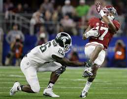 Alabama running back Kenyan Drake (17) makes a reception as Michigan State safety RJ Williamson (26) defends during the first half of the Cotton Bowl NCAA college football semifinal playoff game, Thursday, Dec. 31, 2015, in Arlington, Texas.