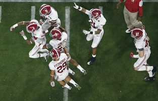 Alabama's Eddie Jackson, far left, celebrates his interception with teammates during the first half of the NCAA college football playoff championship game against Clemson Monday, Jan. 11, 2016, in Glendale, Ariz.