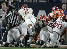 Alabama's Derrick Henry (2) dives into the end zone for a touchdown during the first half of the NCAA college football playoff championship game against Clemson Monday, Jan. 11, 2016, in Glendale, Ariz.