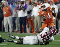 Alabama's Rashaan Evans (32) sacks Clemson quarterback Deshaun Watson during the second half of the NCAA college football playoff championship game Monday, Jan. 11, 2016, in Glendale, Ariz.