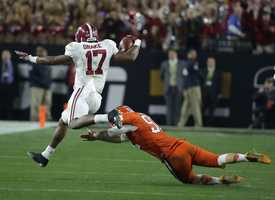 Alabama's Kenyan Drake (17) gets past Clemson's Greg Huegel as he runs back a kick off for a touchdown during the second half of the NCAA college football playoff championship game Monday, Jan. 11, 2016, in Glendale, Ariz.