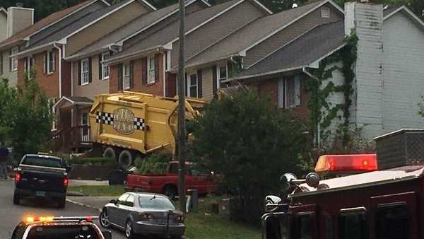 A garbage truck crashed into a house on North Chandler Lane in Pelham on Wednesday.