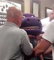 Trussville firefighters had to help a 15-year-old girl get out of the head of a Barney the dinosaur costume.